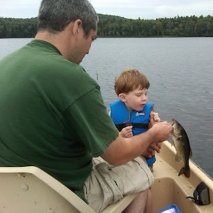 A young son sharing the catch of his first largemouth bass with his father is a special moment indeed.
